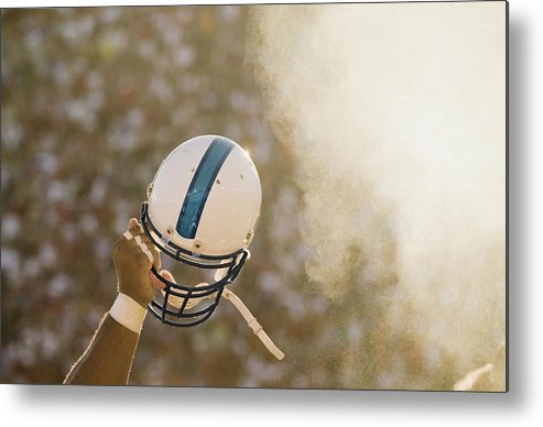 Celebration Metal Print featuring the photograph Football Player Waving Helmet In Air by David Madison