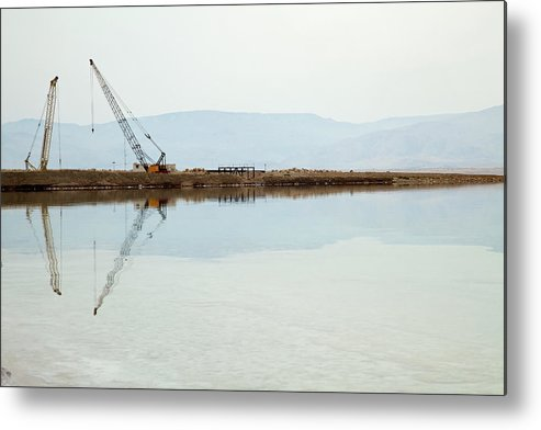 Working Metal Print featuring the photograph Heavy Machinery At The Dead Sea by Eldadcarin