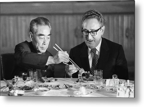 Chinese Culture Metal Print featuring the photograph Kissinger Eating With Zhou Enlai by Bettmann