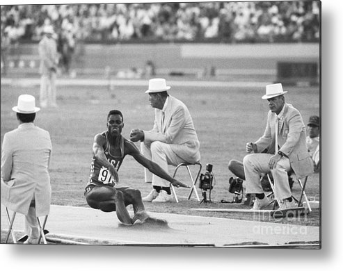 1980-1989 Metal Print featuring the photograph Lewis In The Long Jump At Olympics by Bettmann