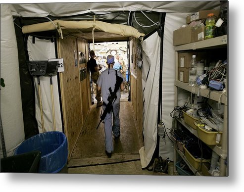 Rifle Metal Print featuring the photograph Medical Personnel At Balad Trauma by Chris Hondros