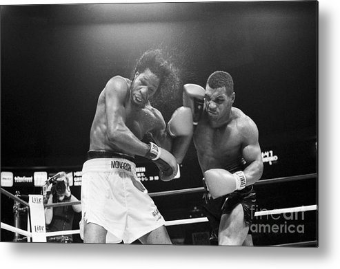 1980-1989 Metal Print featuring the photograph Mike Tyson Punches Mitch Green by Bettmann