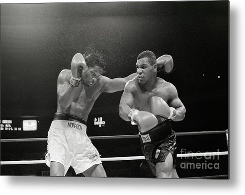 1980-1989 Metal Print featuring the photograph Mitch Green Recoils From Mike Tysons by Bettmann