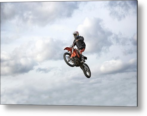 Recreational Pursuit Metal Print featuring the photograph Motocross Rider In Mid-air, Low Angle by Claus Christensen