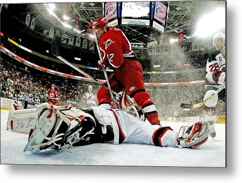 Playoffs Metal Print featuring the photograph New Jersey Devils V Carolina Hurricanes by Bruce Bennett