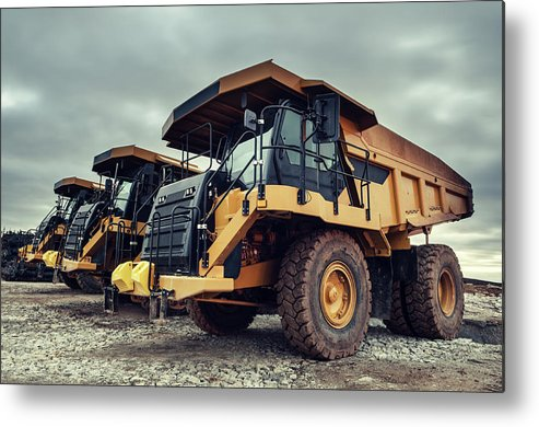 Construction Machinery Metal Print featuring the photograph Off-highway Dump Trucks by Shaunl