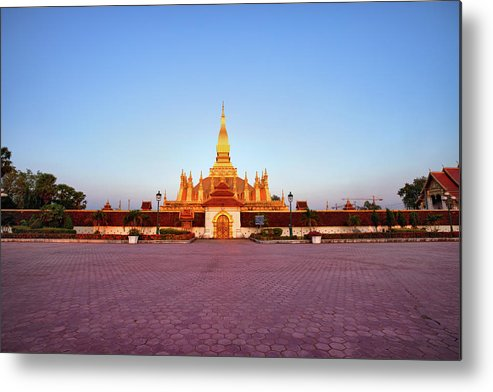 Monument Metal Print featuring the photograph Pha That Luang Stupa At Sunset by Fototrav