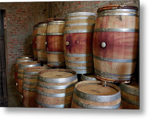 Stellenbosch Metal Print featuring the photograph Pile Of Wooden Barrels At Winery by Klaus Vedfelt