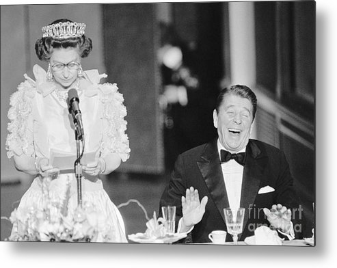 Following Metal Print featuring the photograph President Reagan Laughing At Queens by Bettmann