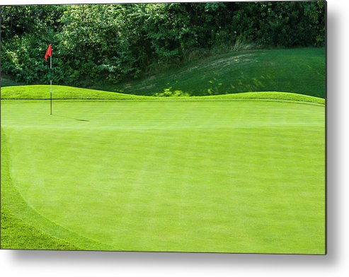 The End Metal Print featuring the photograph Putting Green And Flag At A Golf Course by Stuart Dee