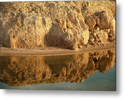 Tranquility Metal Print featuring the photograph Reflection In Water Of Eroding Cliff by Timothy Hearsum