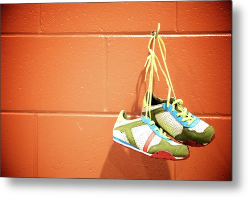 Hanging Metal Print featuring the photograph Runnig Shoes Hanging On A Hook by Pascalgenest