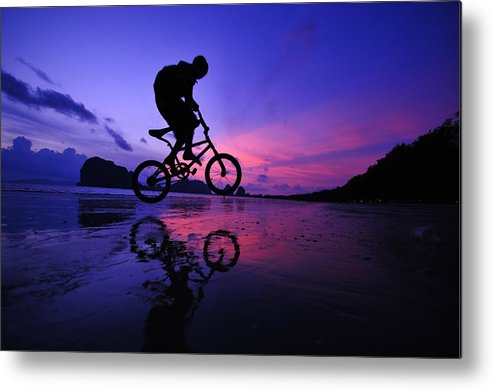 The Twilight Series Metal Print featuring the photograph Silhouette Of A Mountain Biker On Beach by Primeimages