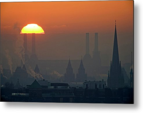 Tranquility Metal Print featuring the photograph Silhouettes Of Chimneys And Spires by James Burns