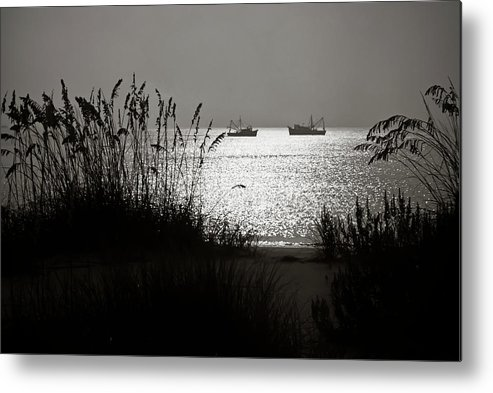 Tranquility Metal Print featuring the photograph Silhouettes Of Sea Oats And Shrimp Boats by Joseph Shields