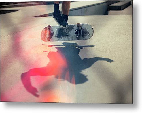 Cool Attitude Metal Print featuring the photograph Skateboarder Doing An Ollie by Devon Strong