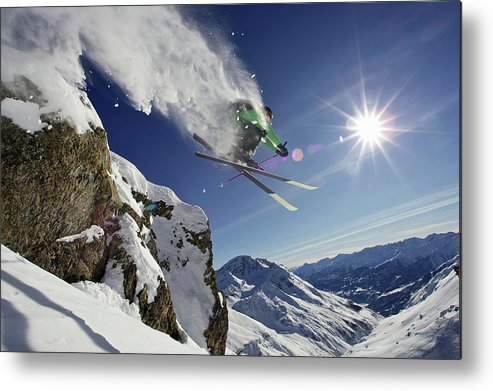 Young Men Metal Print featuring the photograph Skier In Midair On Snowy Mountain by Michael Truelove
