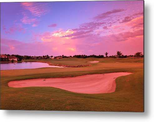 Sand Trap Metal Print featuring the photograph Sunrise View Of A Resort On A Golf by Rhz