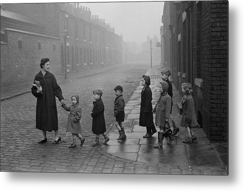 Following Metal Print featuring the photograph Teacher And Pupils In Manchester by Bert Hardy