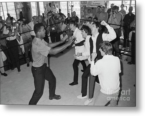Rock Music Metal Print featuring the photograph The Beatles In Ring With Muhammad Ali by Bettmann