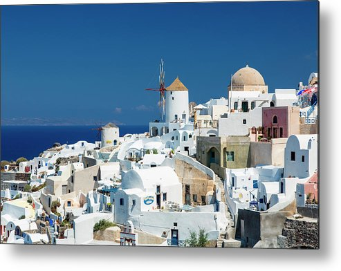 Greek Culture Metal Print featuring the photograph The Small Greek Village Of Oia by Sylvain Sonnet