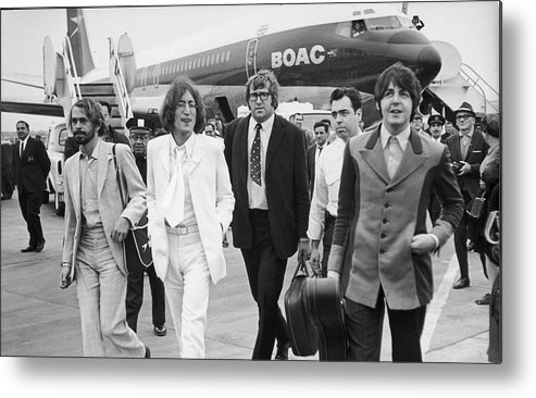 Following Metal Print featuring the photograph Two Beatles Arrive In New York by Fred W. McDarrah