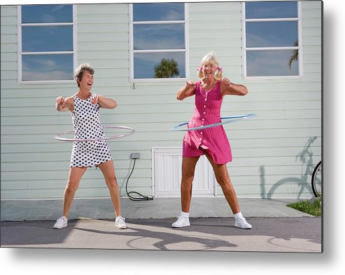 Human Arm Metal Print featuring the photograph Two Senior Women Playing With Plastic by Greg Ceo