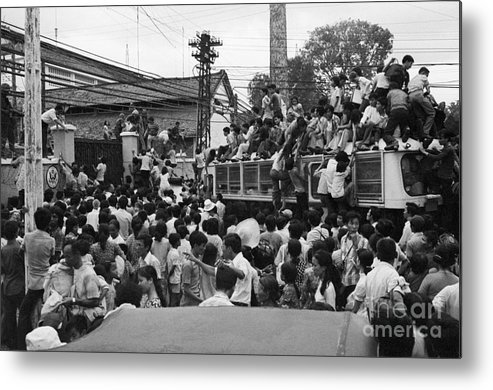 Ho Chi Minh City Metal Print featuring the photograph Vietnamese Civilians Crowding In Front by Bettmann