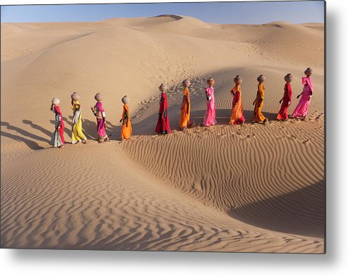 People Metal Print featuring the photograph Women Fetching Water From The Sparse by Mint Images - Art Wolfe