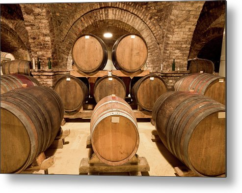 Arch Metal Print featuring the photograph Wooden Barrels In Wine Cellar by Benedek