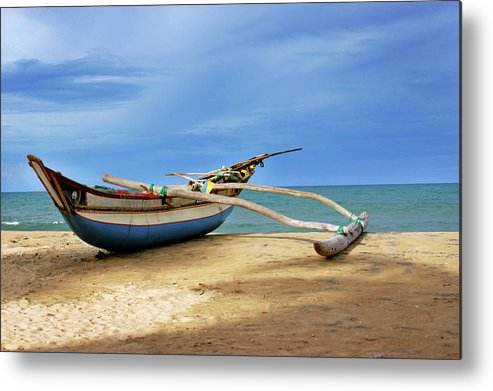 Tranquility Metal Print featuring the photograph Wooden Catamaran By The Sea Shore by Juavenita Alphonsus