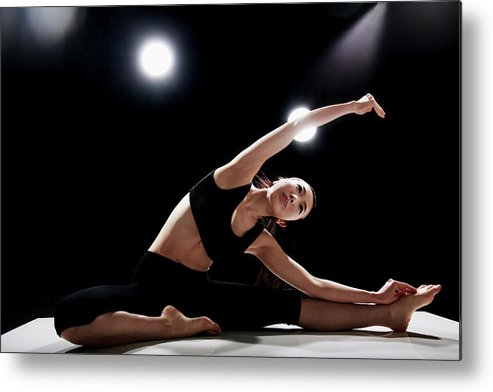 People Metal Print featuring the photograph Young Woman Stretching by Runphoto