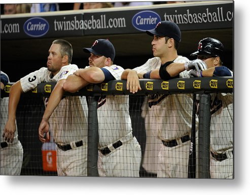 Joe Mauer Metal Print featuring the photograph Detroit Tigers v Minnesota Twins by Hannah Foslien