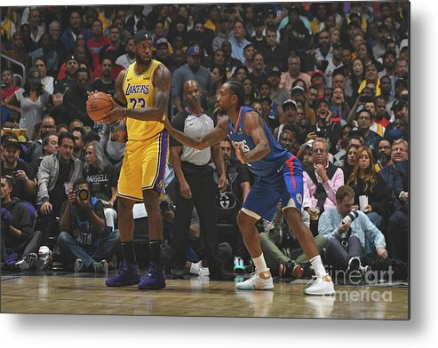 Nba Pro Basketball Metal Print featuring the photograph Kawhi Leonard and Lebron James by Andrew D. Bernstein