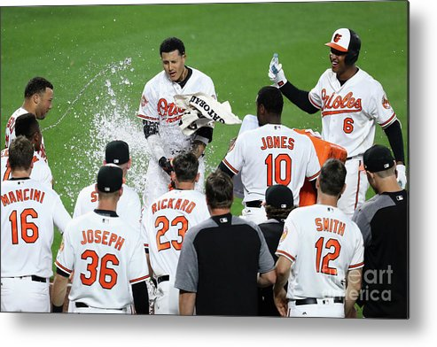 People Metal Print featuring the photograph Manny Machado, Jonathan Schoop, and Adam Jones by Rob Carr