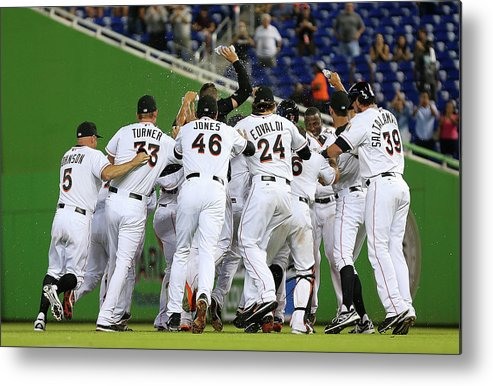 American League Baseball Metal Print featuring the photograph Marcell Ozuna by Mike Ehrmann