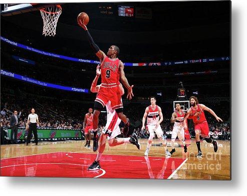 Nba Pro Basketball Metal Print featuring the photograph Rajon Rondo by Ned Dishman