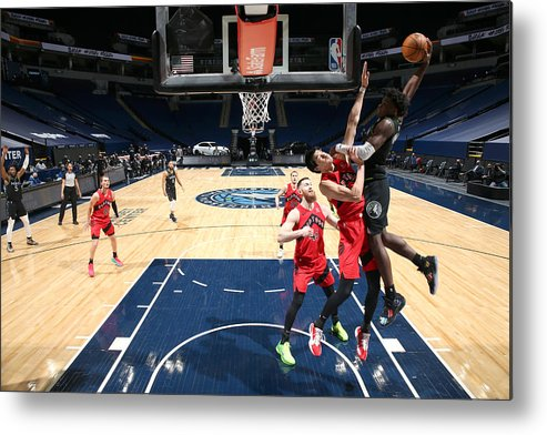 Nba Pro Basketball Metal Print featuring the photograph Toronto Raptors v Minnesota Timberwolves by David Sherman