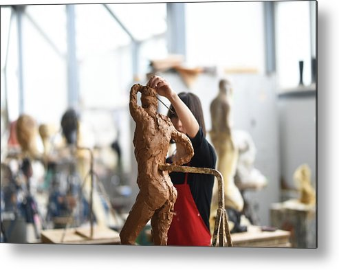 Working Metal Print featuring the photograph Young Female Sculptor Is Working In Her Studio by Baranozdemir