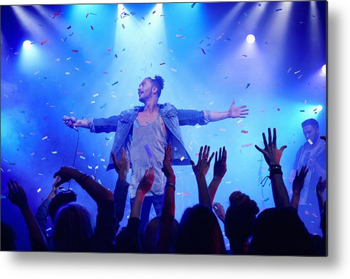 Young Men Metal Print featuring the photograph Band performing on stage at music concert by Flashpop