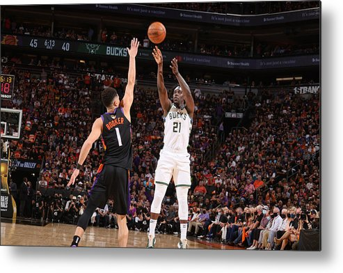 Playoffs Metal Print featuring the photograph Jrue Holiday by Nathaniel S. Butler