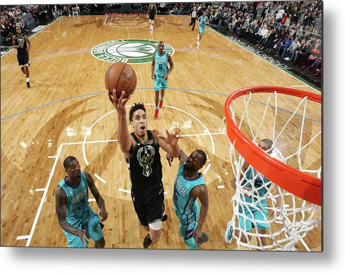 Nba Pro Basketball Metal Print featuring the photograph Malcolm Brogdon by Gary Dineen