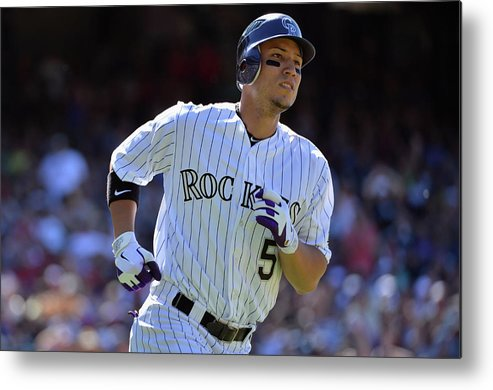 American League Baseball Metal Print featuring the photograph Carlos Gonzalez by Doug Pensinger