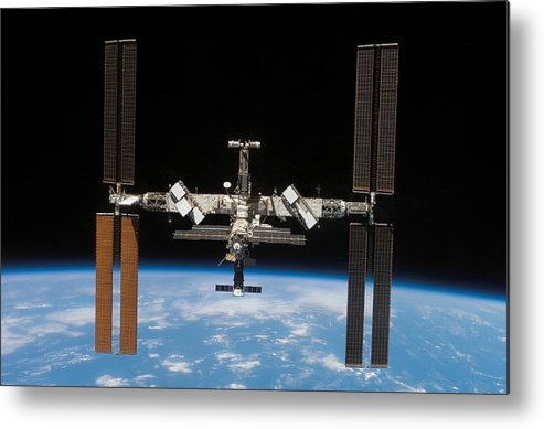 Curve Metal Print featuring the photograph International Space Station by Stocktrek Images