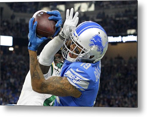 Detroit Metal Print featuring the photograph Green Bay Packers v Detroit Lions by NurPhoto