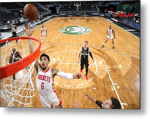 Nba Pro Basketball Metal Print featuring the photograph Houston Rockets v Milwaukee Bucks by Gary Dineen