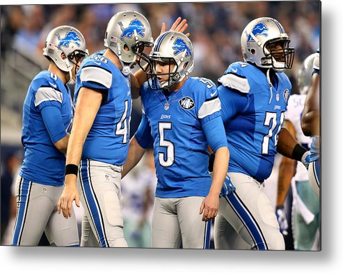 Playoffs Metal Print featuring the photograph Wild Card Playoffs - Detroit Lions v Dallas Cowboys by Ronald Martinez