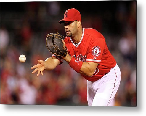 American League Baseball Metal Print featuring the photograph Albert Pujols, Nick Franklin, and Cam Bedrosian by Stephen Dunn