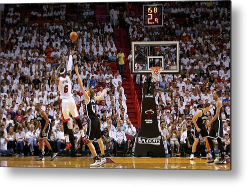 Playoffs Metal Print featuring the photograph Andrei Kirilenko and Lebron James by Mike Ehrmann