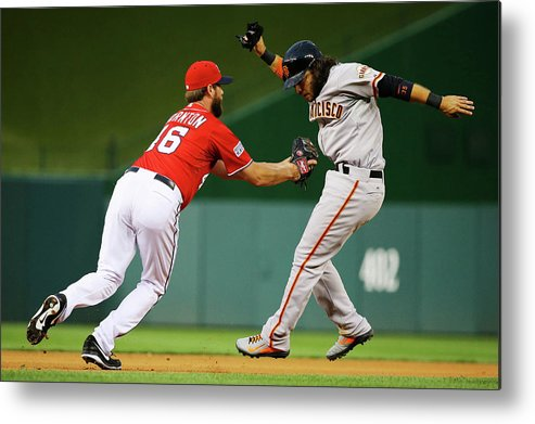National League Baseball Metal Print featuring the photograph Brandon Crawford and Matt Thornton by Al Bello